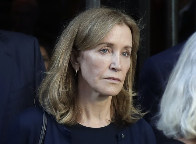 Actress Felicity Huffman leaves federal court after her sentencing in a nationwide college admissions bribery scandal