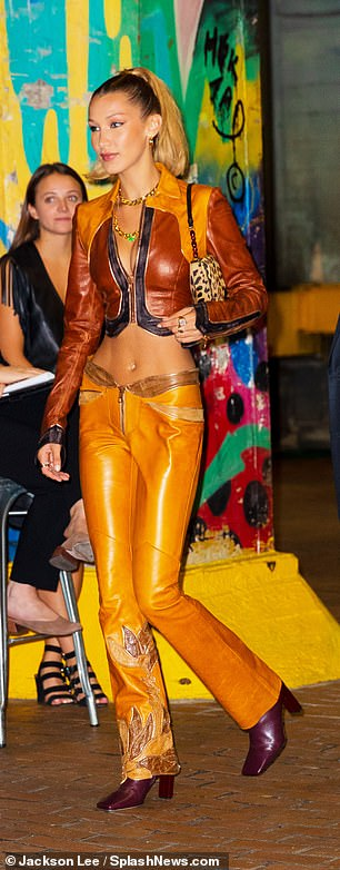 A vision:The supermodel, 22, flashed her rock hard abs in a country-western inspired ensemble complete with a tan leather jacket-crop top hybrid