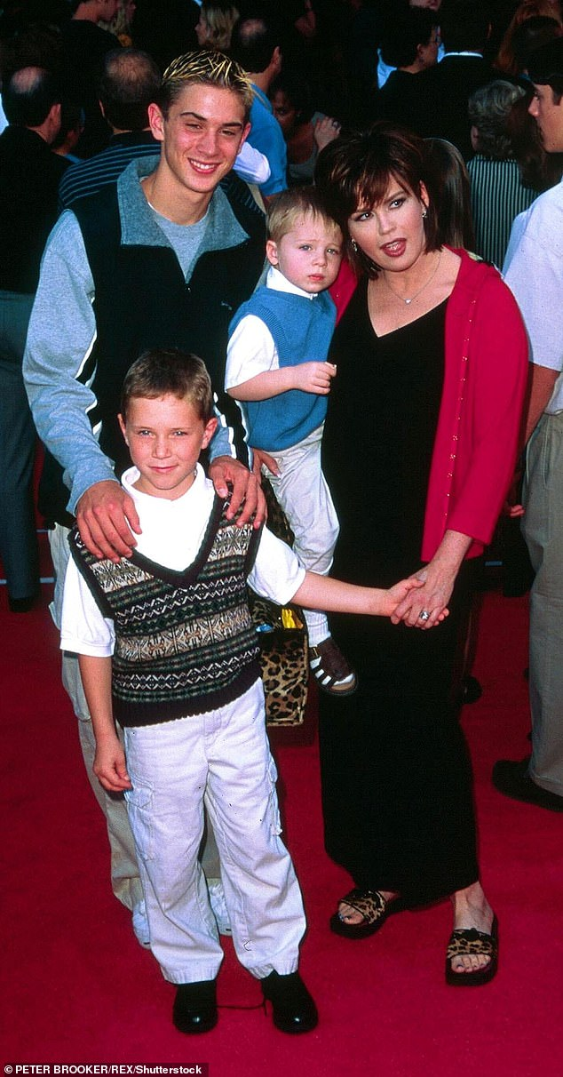 Troubled: Michael, front, pictured with his mom and brothers in 1999, suffered from depression and struggled with drug and alcohol addiction. He killed himself by jumping off an apartment building in LA and in a suicide note, he spoke about feeling like he had no friends