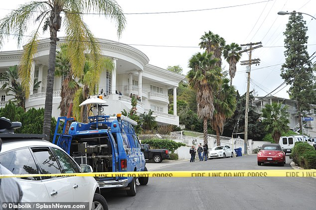 Mall's home: Authorities blocked off the road outside of Mall's home during the raid. There had been reports of 'multiple rapes and human sex trafficking, as well as firearms on the premises'