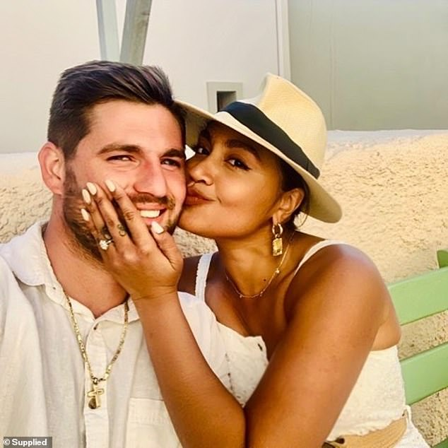 Candid: When radio host Kyle Sandilands asked Jessica if she wanted to adopt instead of conceiving naturally, she responded by saying that she doesn't even know if she is able to have children. Pictured withfiancé Themeli