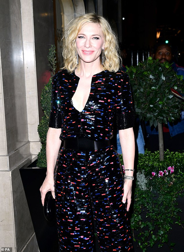 Glam:The actress, 50, looked stunning in the one-piece with a plunging front as she arrived to accept the Philanthropy Award at Claridge's Hotel in London on Tuesday