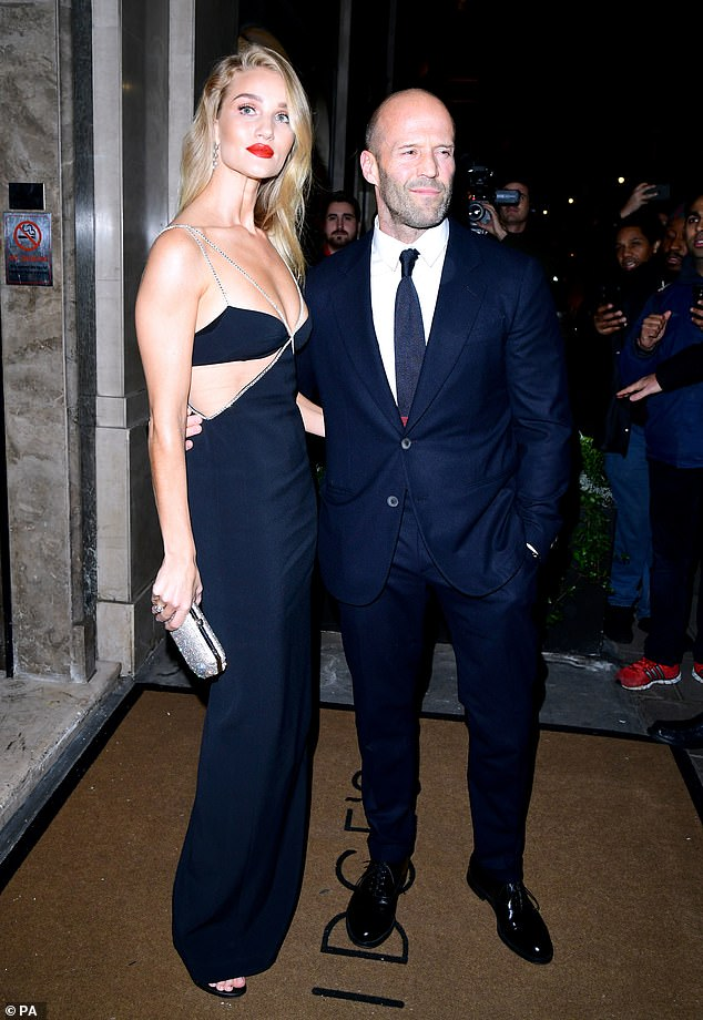 Amazing: Also among the guests in attendance was Rosie Huntington-Whiteley, who put on a racy display in a stunning black gown as she cosied up to her fiancé Jason Statham.