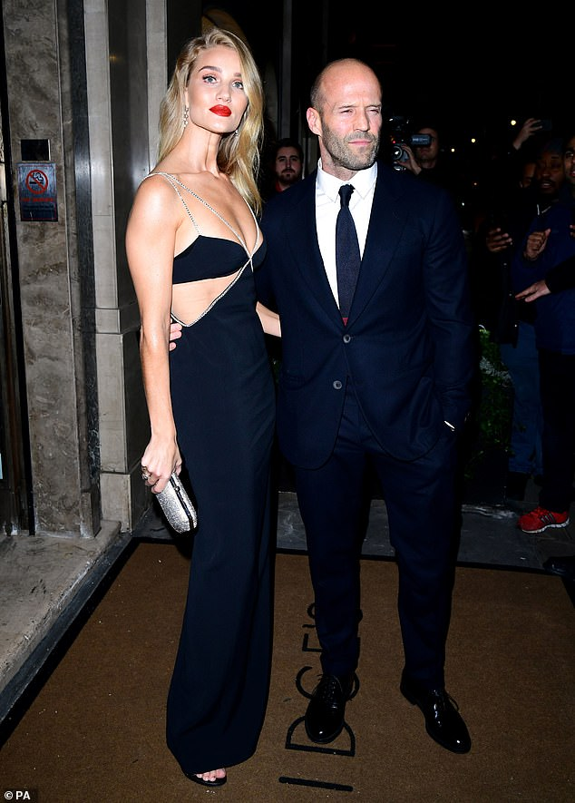 Incredible: The model, 32, looked stunning in the floor-length black gown with a silver diamante trim and side cutouts