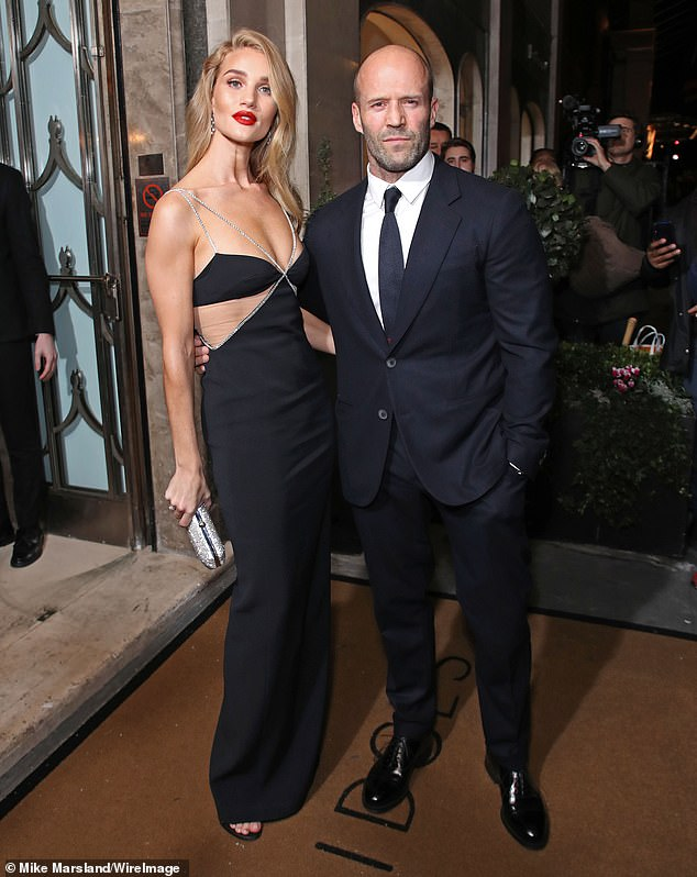 Suave: Her fiancé Jason, 52, looked equally dapper in a matching black suit as the couple headed into the awards show