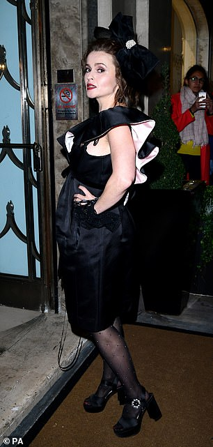 Quirky: She showedoff her kooky sense of style in a black frilled dress