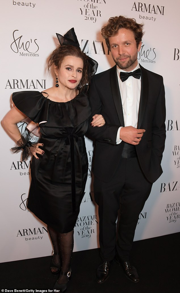 Cosy: Inside the awards show Helena was also joined by her suave boyfriendRye Dag Holmboe, 32
