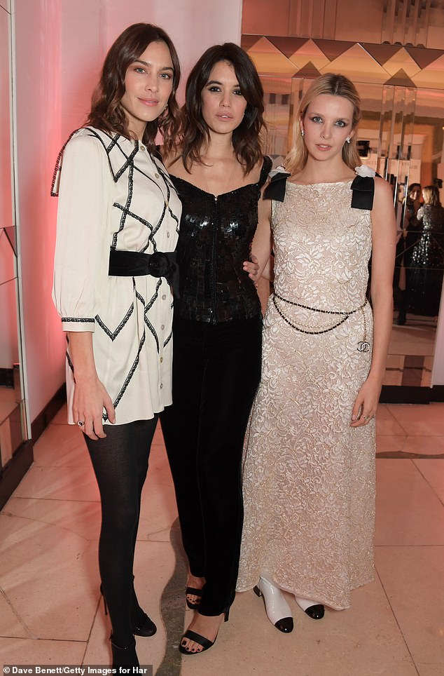 Simple: Alexa still highlighted her slender pins in the dress which she teamed with simple black tights (pictured with Gala and actressGreta Bellamacina)