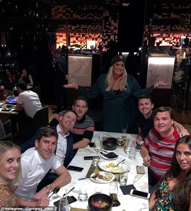 Group pic: Greg Shepherd shared a snap from the evening in Dubai with Gemma stood at the head of the table smiling as she held her arms out. He captioned the picture 'Dubz!'