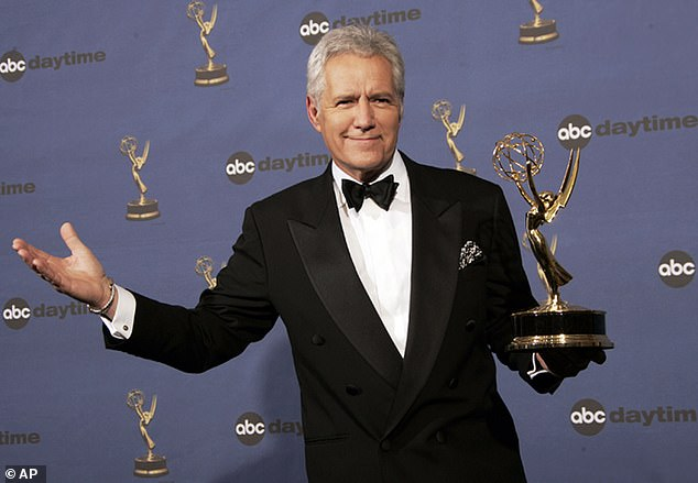 Trebek revealed he was diagnosed with stage 4 pancreatic cancer in a video message posted to YouTube in March 2019.Pictured: Trebek holds the award for outstanding game show host at the Daytime Emmy Awards in April 2006