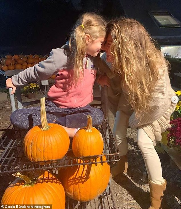 That time of year: She wrote in the caption: 'The kids are so excited to make their Halloween lanterns and all I can think about is delicious pumpkins seeds and muffins!'