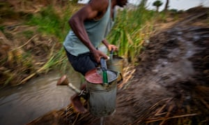 A farmer carrying water