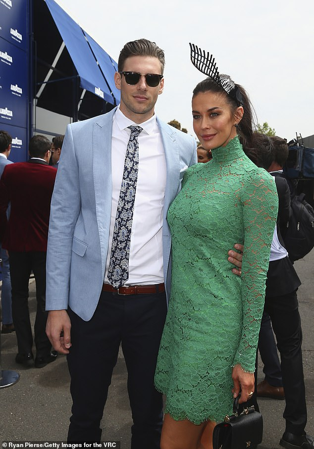 Trackside regular: Megan, 44, has been a regular among the marquees at Flemington for years but offered no explanation as to why she won't attend next week when she announced her absence on Thursday. Pictured with her fiancé, Shaun Hampson at the 2015 Melbourne Cup