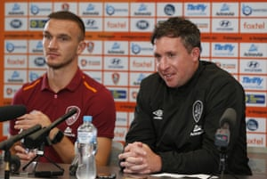 Brisbane Roar captain Tom Aldred faces the media with new coach Robbie Fowler