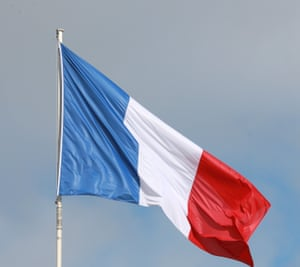 The French flag is pictured in the sky over the Elysee Palace in Paris