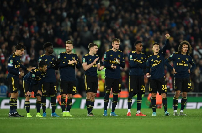 The Arsenal players line up for the penalty during the Carabao Cup Round of 16 match between Liverpool and Arsenal at Anfield