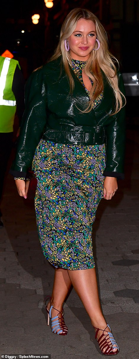 Suited up:Iskra Lawrence glowed in a lustrous dark green jacket with wide peaked lapels