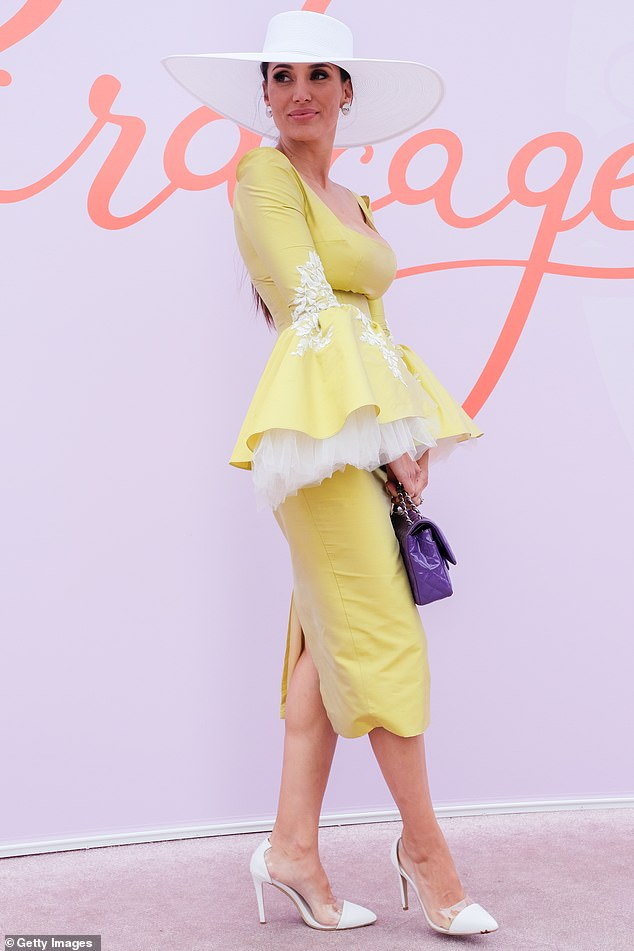 Show-stopping!  Snezana (pictured) oozed glamour in a mustard coloured skirt and matching corset top with flared sleeves