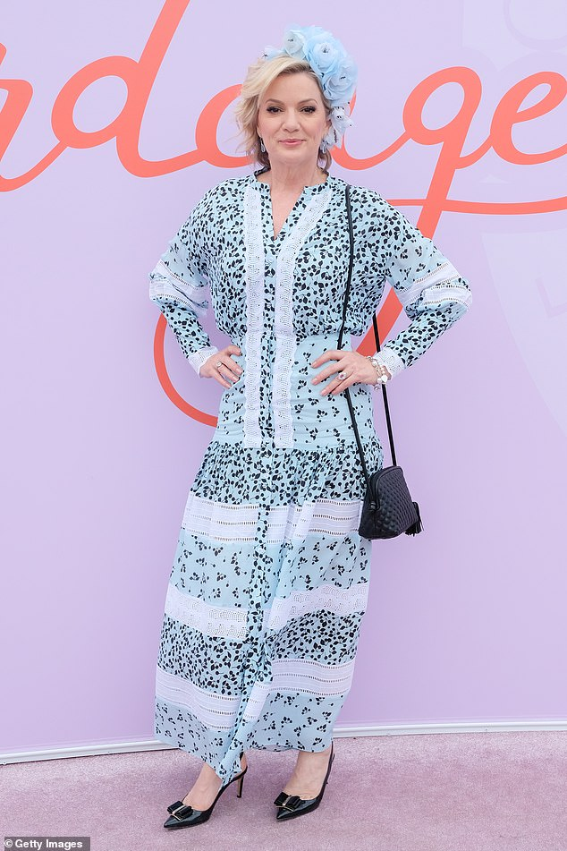 Blue beauty: Sandra Sully (pictured) also dressed to impress in a stylish long blue frock which featured a black print