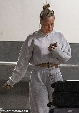 Make-up free: She swept her blonde locks into a bun and appeared to go make-up free