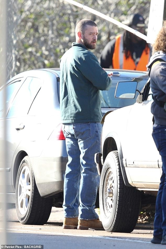 Working man: Stylists dressed the star in a blue zipped jacket and and worn jeans