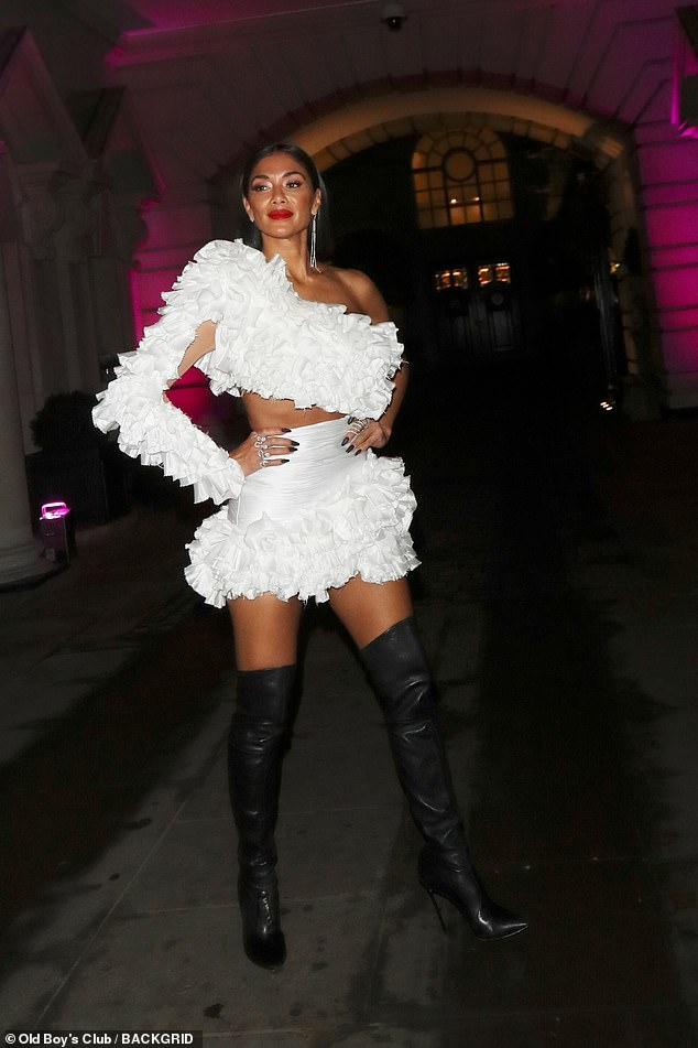 Outfit: The singer paired it with a matching miniskirt while she added height to her frame with a pair of black thigh-high boots