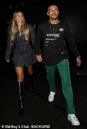 Happy man: Wes flashed a wide smile as he left hand in hand with Arabella Chi