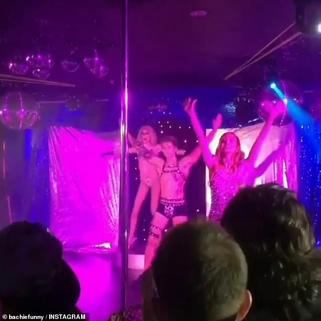 Guess who! During his time on The Bachelorette, Ciarran opened up to Angie about his raunchy past as a stripper at a gay nightclub in Darwin. Pictured centre in 2018