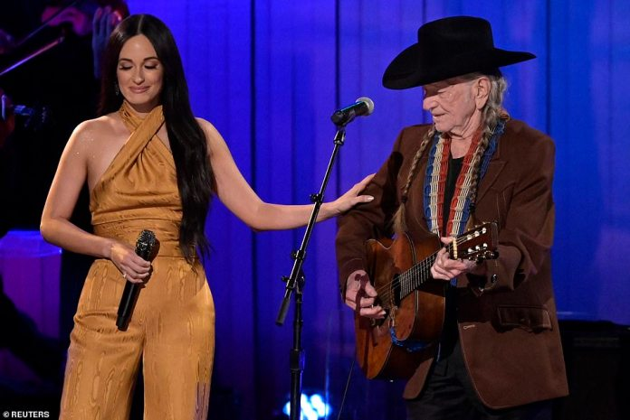 Kacey and Willie: Kacey Musgraves performs with Willie Nelson at the CMAs