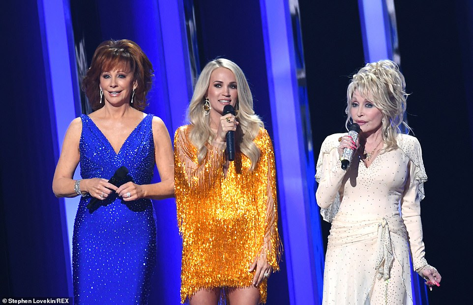 Three hosts:The hosts all took to the stage, with Parton starting the night with a joke, stating, 'What do you call three women hosting the CMA's? Your lucky night!'