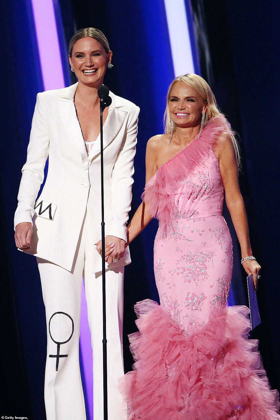 Jokes:Jennifer Nettles and Kristen Chennoweth took the stage to present the Song of the Year Award, as they embraced on stage with some jokes