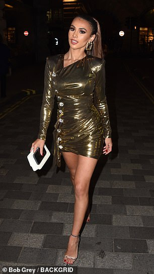 Out on the town: Joanna, 23, commanded attention in a metallic gold dress