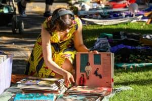 Young woman Browsing vinyl at pop-up flea market in the Kallio district of Helsinki,