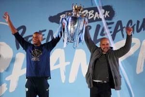 Kompany celebrates winning the Premier League title with Pep Guardiola last season.