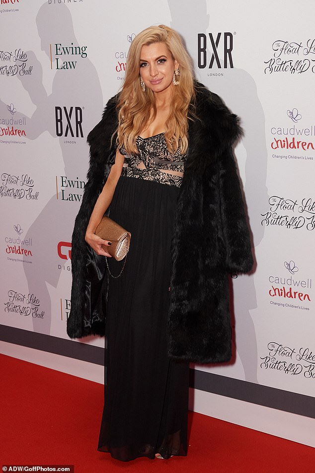 Upping the glam: Victoria Brown wrapped up in a huge black furry coat