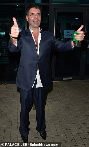 Beaming: Simon couldn't help but show a thumbs up