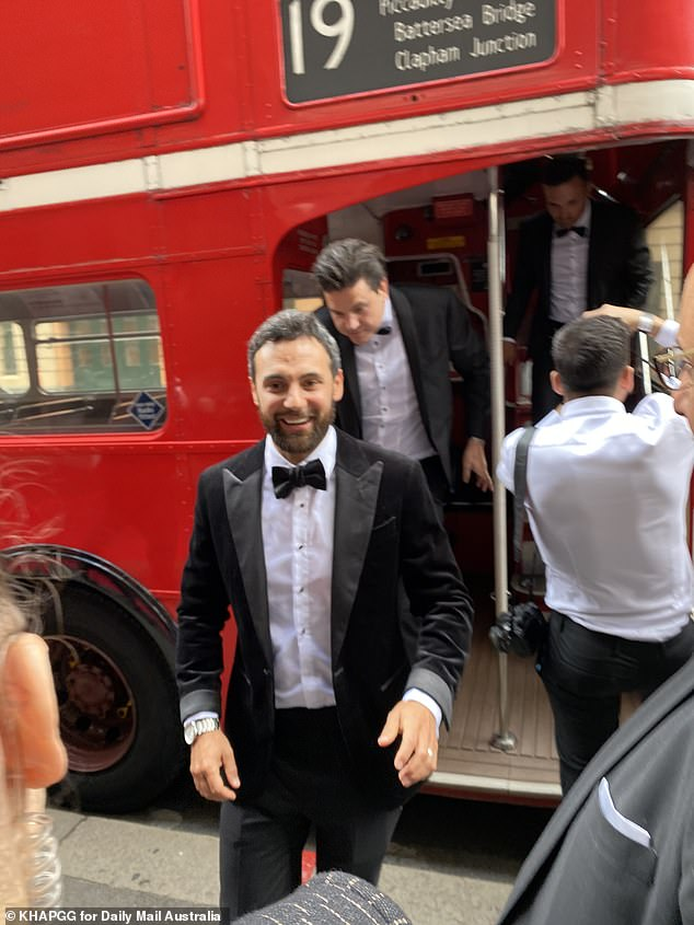 Cheerful! The soon-to-be wed reality star, 35, was absolutely beaming as he disembarked from a red double-decker bus which was carrying the guests
