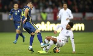 Kosovo's Valon Berisha in action with England's Alex Oxlade-Chamberlain.