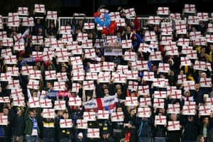 Supporters in the stadium bearing England flags.