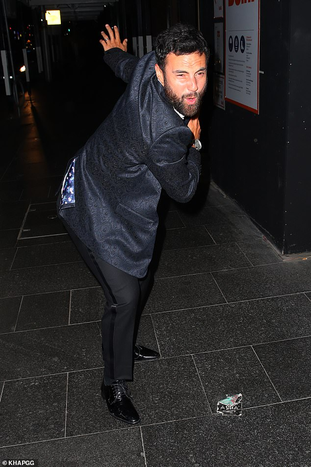 Strike a pose! The reality star happily goofed around as he left the venue