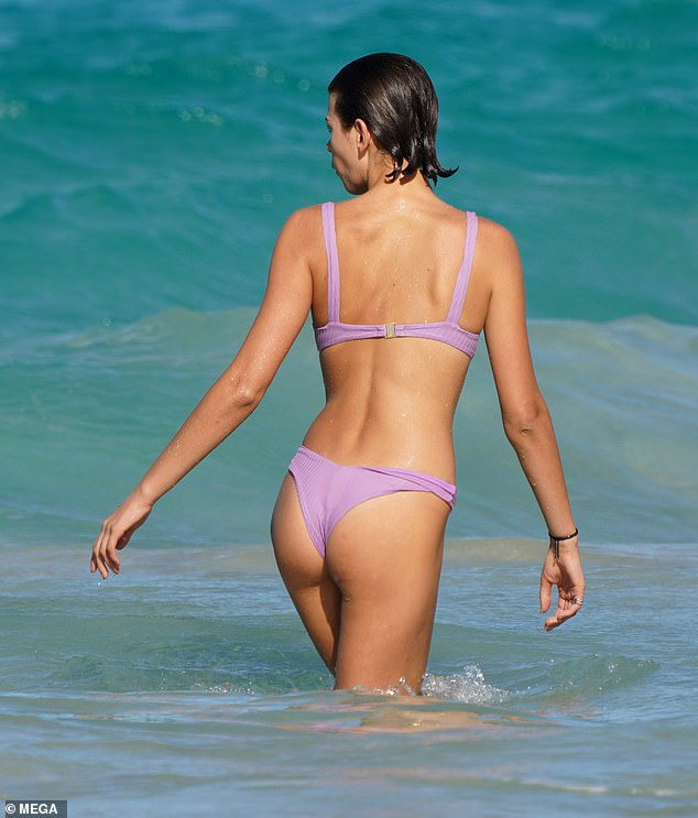 Sun's out, buns out! Her bikini featured a bustier-style bra and cheeky-cut bottoms
