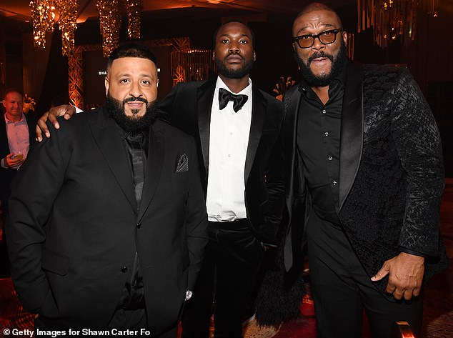 Trio: Tyler could be spotted getting his picture taken in the casino with musical personalities DJ Khaled and Meek Mill