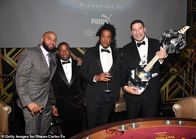 Lovely way to spend an evening: Juan 'OG' Perez and Yo Gotti posed beside the table with Jay and the businessman Marcelo Claure, CEO of SoftBank Group International