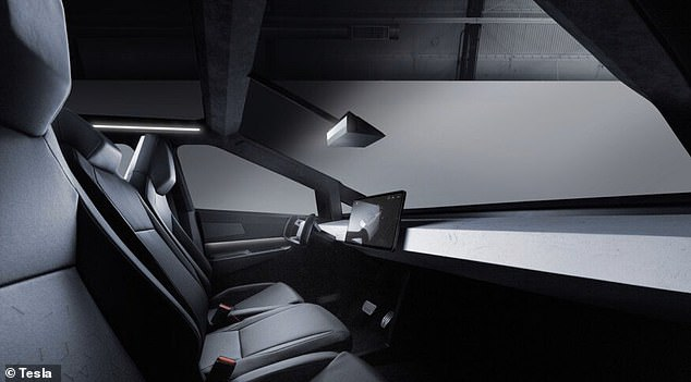 An interior view shows the dashboard and steering column of the new cybertruck