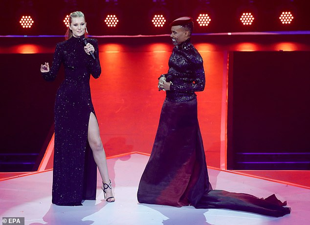 Co-hosts: The model hosted the event alongside Pose star Billy Porter, 50, and underwent two outfit changes for the bash