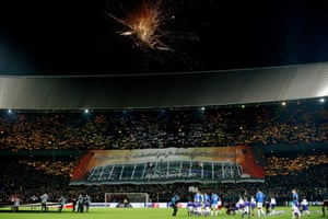 Fireworks and banners greet the players as they take to the field at Feyenoord.