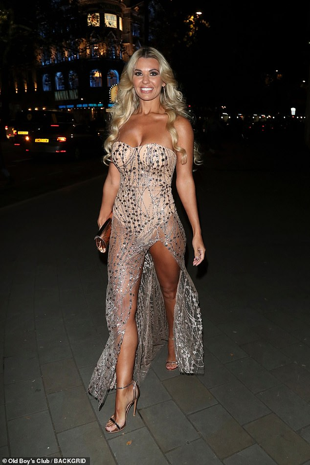 Wow: Christine McGuinness made a show-stopping arrival at the Float Like A Butterfly Ball, held in London's Grosvenor House Hotel, Park Lane on Saturday night
