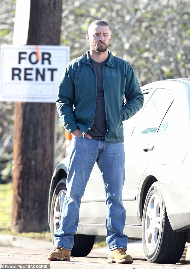 Radiating danger: Justin Timberlake looked menacing as ex con Eddie Palmer as he stood by a car on the set of his new movie inNew Orleans, Louisiana, on Friday