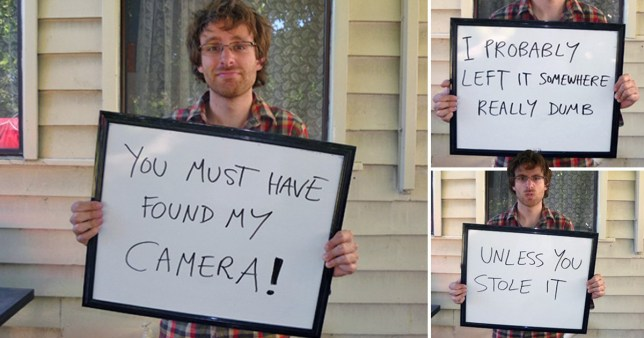 Man holding signs inducting finder of lost camera to return it (Picture: Andrew McDonald)