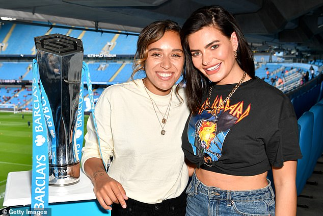 Back together: Megan Barton-Hanson, 25, and Chelcee Grimes, 27, have rekindled their romance as the pair kissed during a cosy night in on Sunday night
